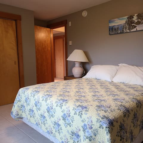 Master bedroom with views of Sunday River ski trails. Queen size bed. Large closet.