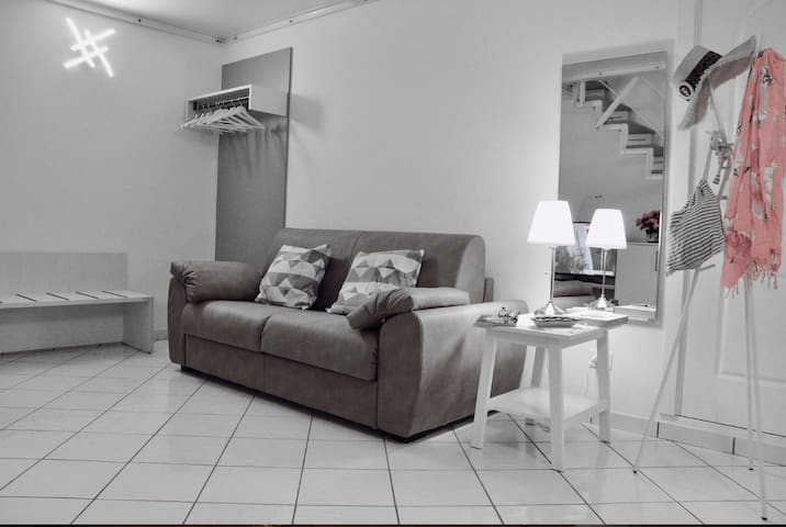 Living room with sofa bed with access to the intermediate floor