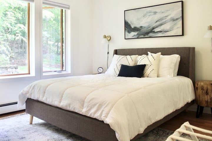 "First floor bedroom - queen mattress, dresser, closet, sound machine, 32"" smart TV, full size mirror, blackout shades and ceiling fan"
