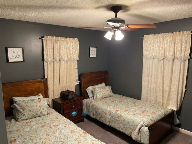 Master bedroom has twin beds and 1/2 bath
