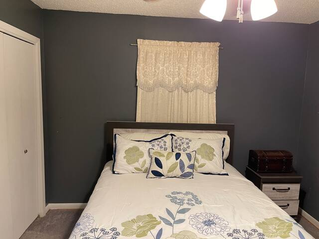 Bedroom on the left has queen bed and small computer desk