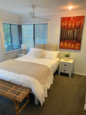 Queen bedroom with ensuite bathroom and access to upper deck