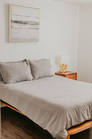 Master Bedroom - comfortable queue bed with high-end linens.