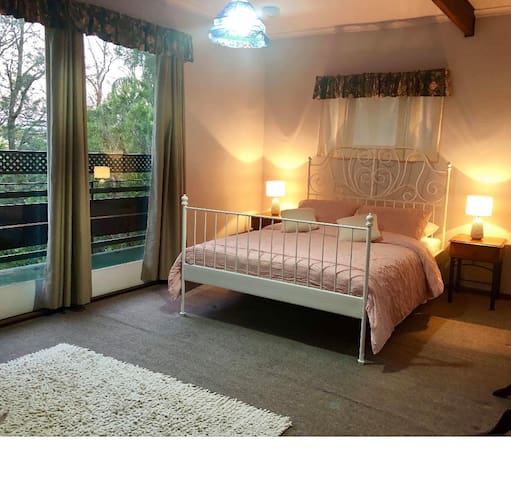 Big main bedroom with verandah access, sofa and walk in robe.