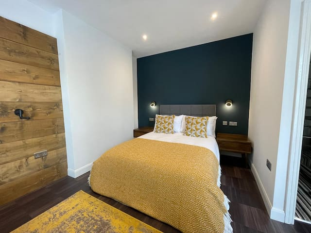 Comfy double bed with high quality linens plus reading lights and USB charging points