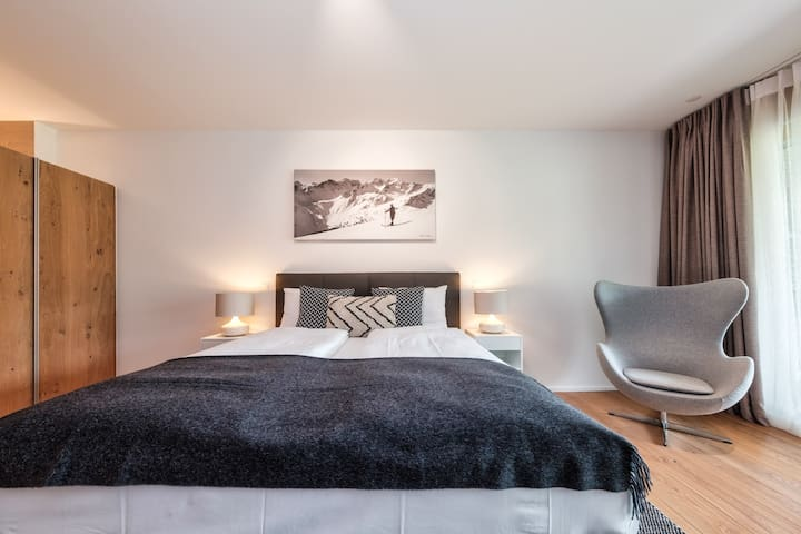 master suite is setup with 1.8m * 2m comfortable leather bed and a classic lounge chair.