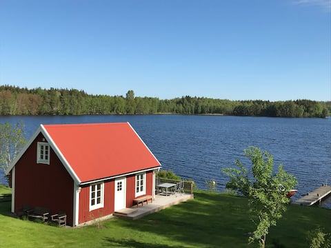 New beach house with sauna, boat and bridge.