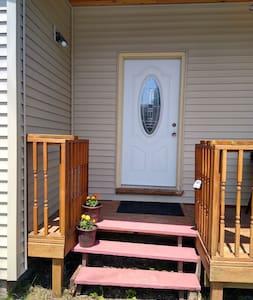 Well lite entrance side door. two steps up.