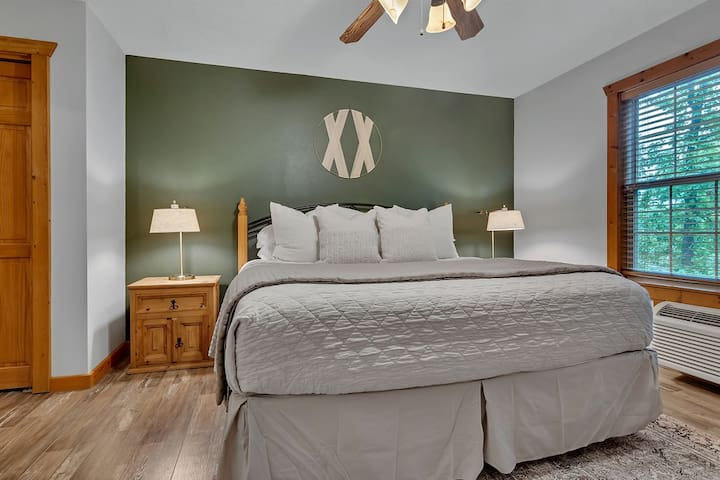 The king bed and beautiful decor make this little cabin the perfect retreat!