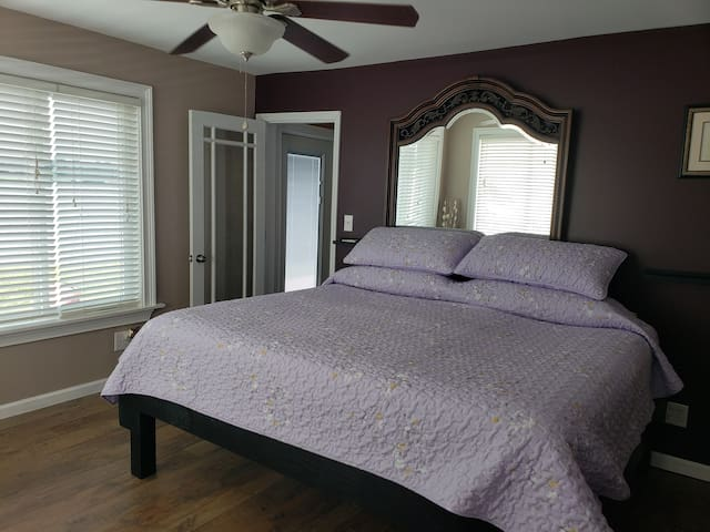Comfortable King size bed. This bedroom also has a ceiling fan with remote control.