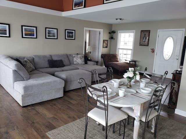 Large spacious living room with dining area.  Sofa sectional offers plenty of room to relax and watch tv. Also has a dining table with room for 4.