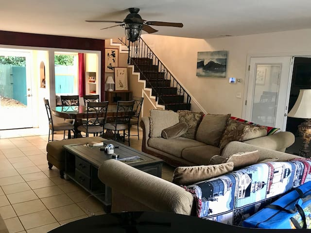 Large living/dining room downstairs, with stairs to upstairs bedroom as well as door to private back yard. There are two sofas that can be used for sleeping and there is a camping bunkbed available for extra guests (sleeping bags needed).