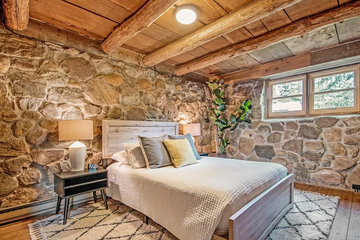 This bedroom has a queen-sized bed and a connected bathroom.