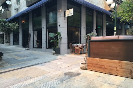 The entrance of the building is next to that beautiful restaurant