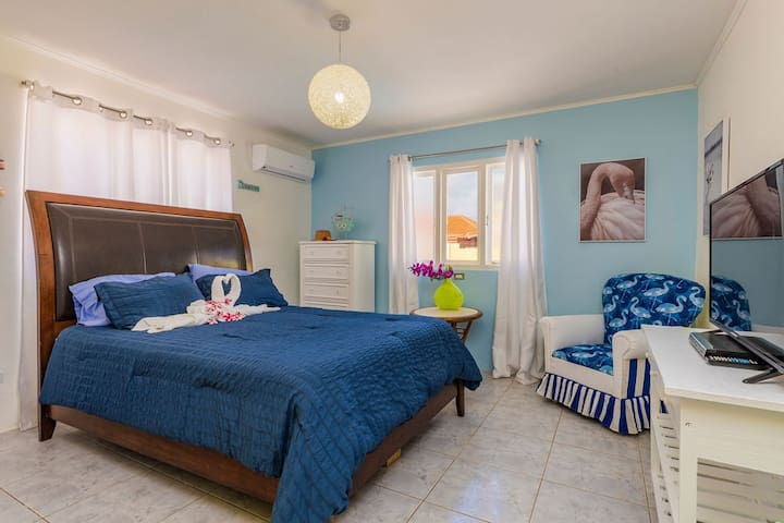 Beautiful second bedroom overlooking the pool!  We love this room as it is so full of light and amazing decoration!  We have included a smart tv and DVD player.