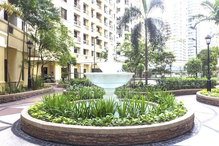 Tower 6, our place, is the first tower on the left of this fountain.