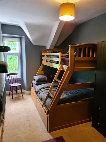The second bedroom has a double bed with a single above.