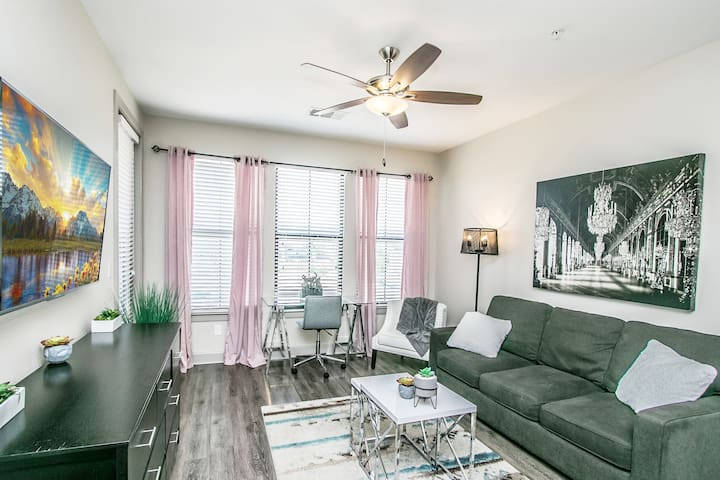 Spacious living area with dinning table, youtube tv and patio.
