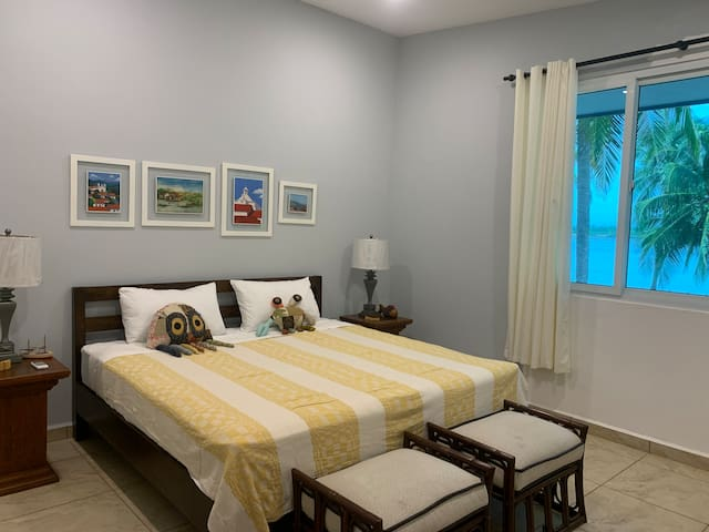 Spinner Dolphin room: king size and twin size beds with estuary view