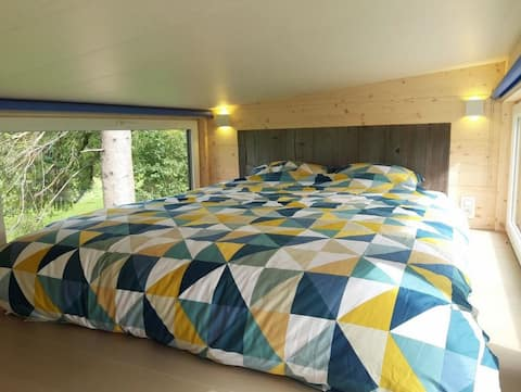 Tiny house chaleureuse dans un cadre idyllique