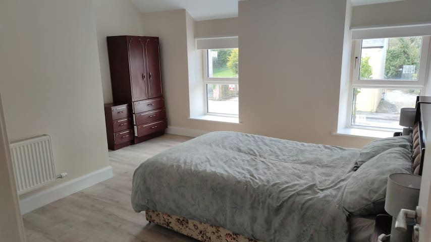 Bedroom 2 with double bed and large space for additional bed if needed.