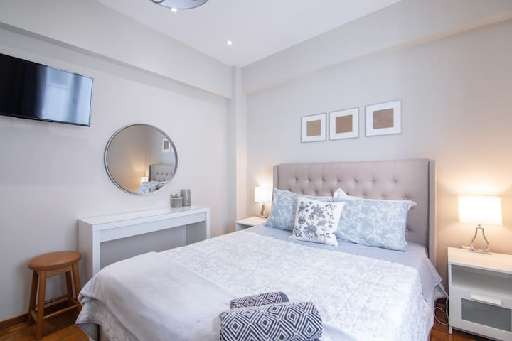 Spacious king size bed, vanity, television & built in wardrobe.