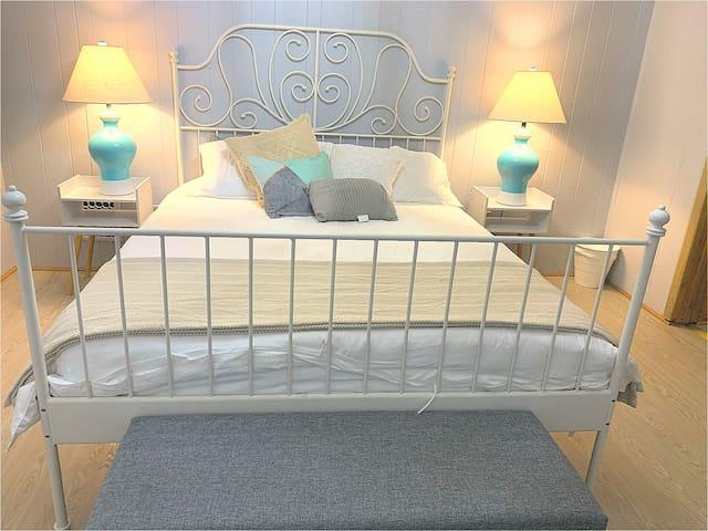 Cute bedroom with queen bed