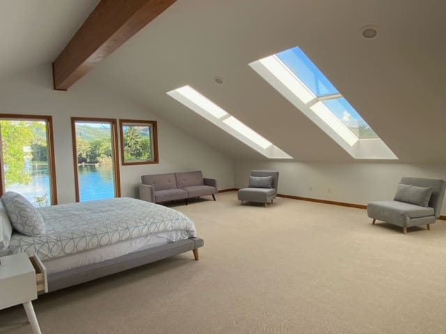 Upstairs master with river and mountain (hills, really) views - skylights fill the room with natural light and let you fall asleep under the stars.