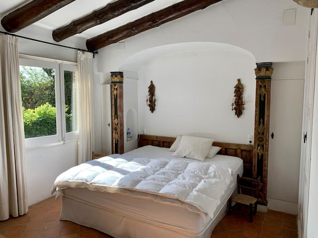 Master bedroom with queen size bed, plenty of closet space, A/C and views over the private garden.