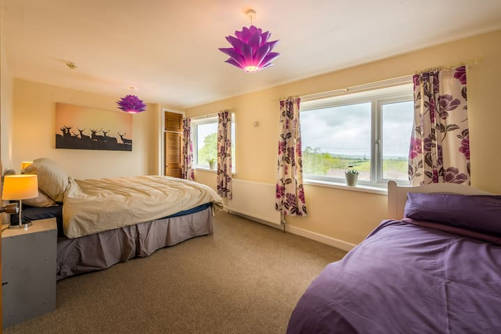 Bedroom with superking bed & single, this room has an ensuite bathroom and amazing views over Exmoor.
