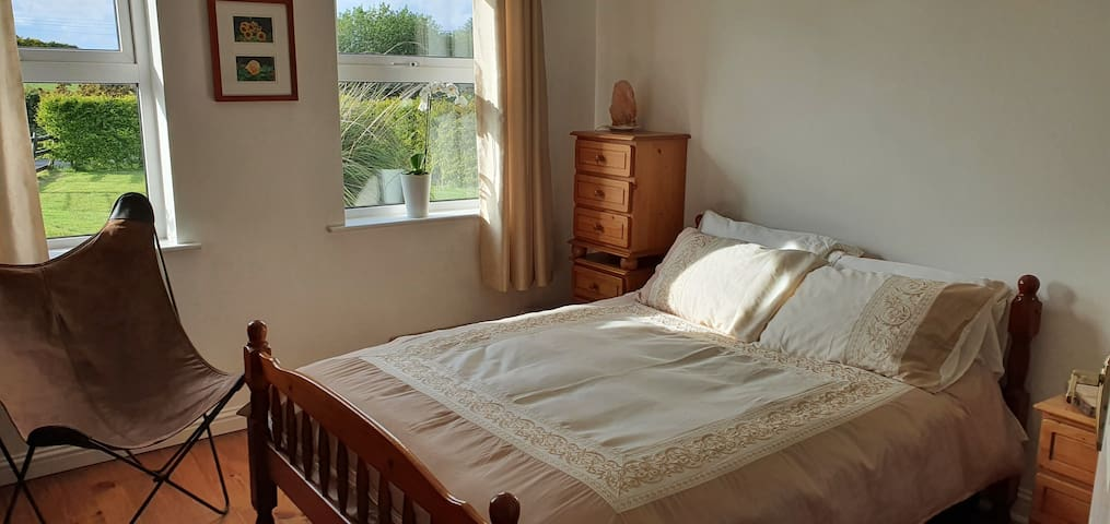 ...guest bedroom with evening sunshine