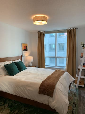Large bedroom boasts a queen bed.