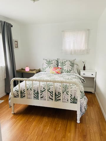Bedroom 1, features Organic Cotton bedding, feather down comforter, a SleepOnLatex mattress, and Desert Mist Diffuser