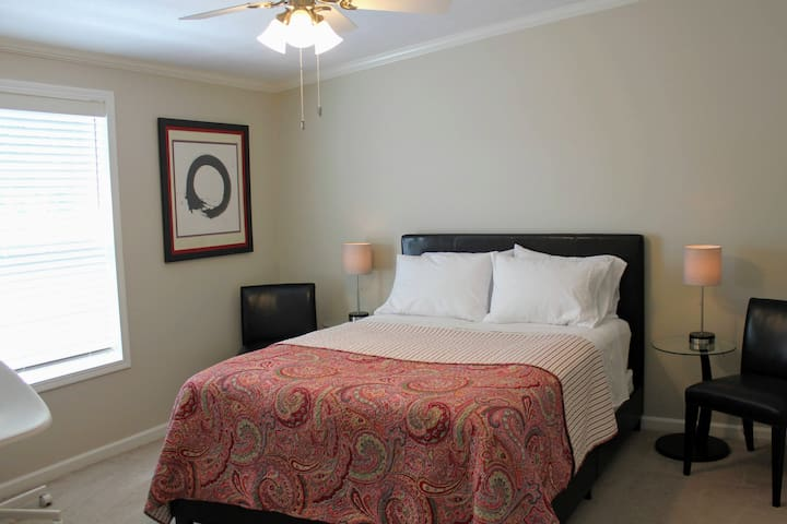 Feel refreshed after a good night's sleep on the queen size memory foam mattress in the Master Bedroom.  Charge your phone or fitness device using the lamp's USB ports.  A large walk-in closet stores all your gear out of site.
