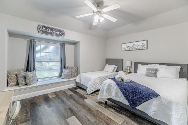 Upstairs guest room with a twin size and queen size bed.