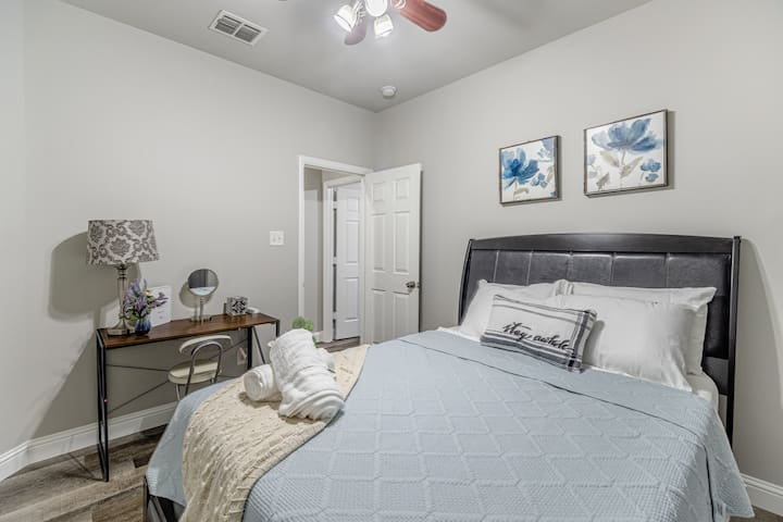 Upstairs guest room with a queen size bed.