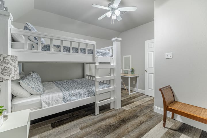Upstairs guest room with a queen size bunk bed.