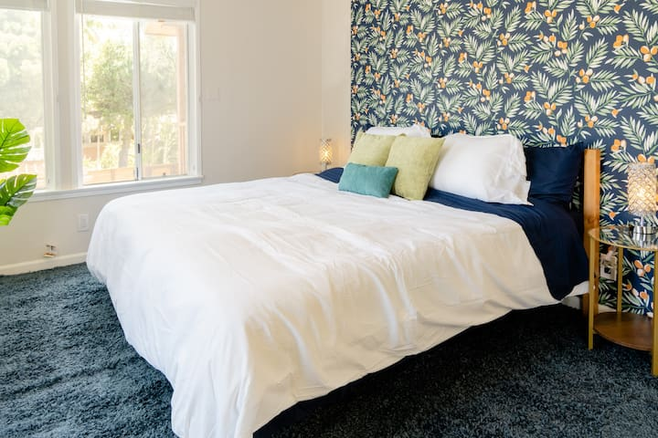 """A King-sized bed with 12"""" memory foam mattress, deluxe bedding and pillows make for a great sleep. Black-out blinds keep the bedroom dark even in the middle of the day."""