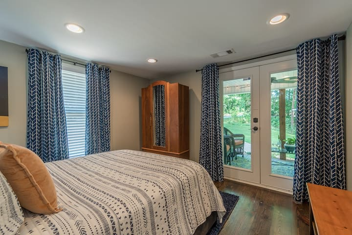 Blue bedroom leads to covered side porch Queen bed with shared bath
