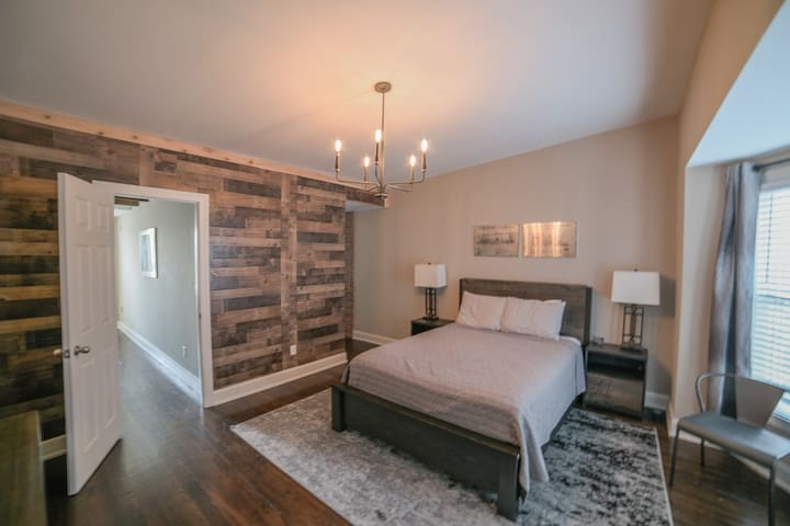 This bedroom is on the third floor in the front of the home. It has a full bathroom with a tub and shower and walk in closet.