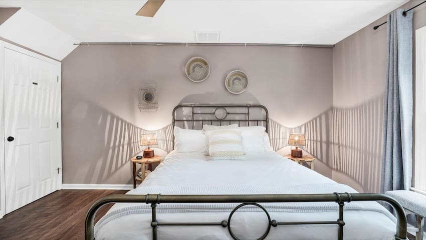 The downstairs bedroom has a queen-sized bed and an en-suite bathroom.