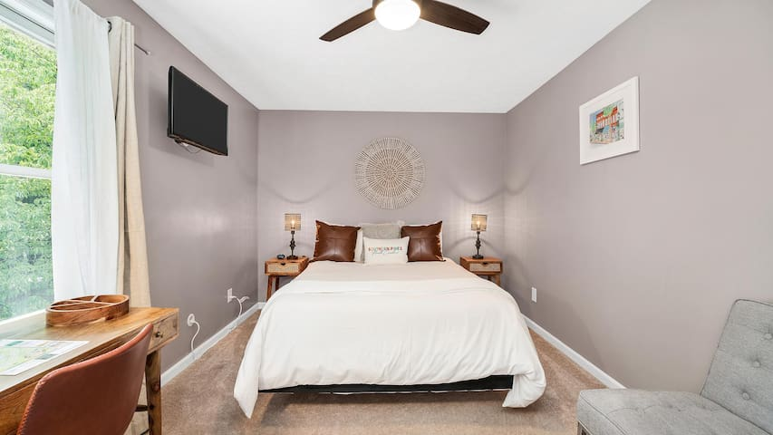 The upstairs bedroom has a queen-sized bed and a smart TV already logged into Netflix. There is also a desk that can serve as your workspace.
