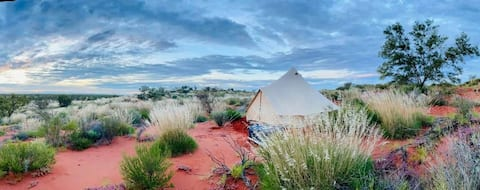 Luxury bell tents on red sand dunes