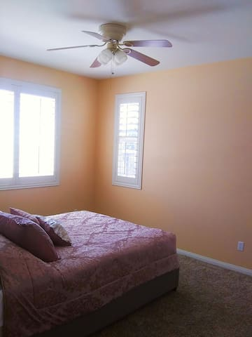 Bedroom 3 with ceiling fan, full closet area, massage chair and partial mountain views.