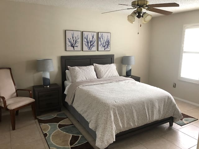 Master bedroom with new furniture and bedding with additional access by pocket door to the bathroom. Very comfortable!