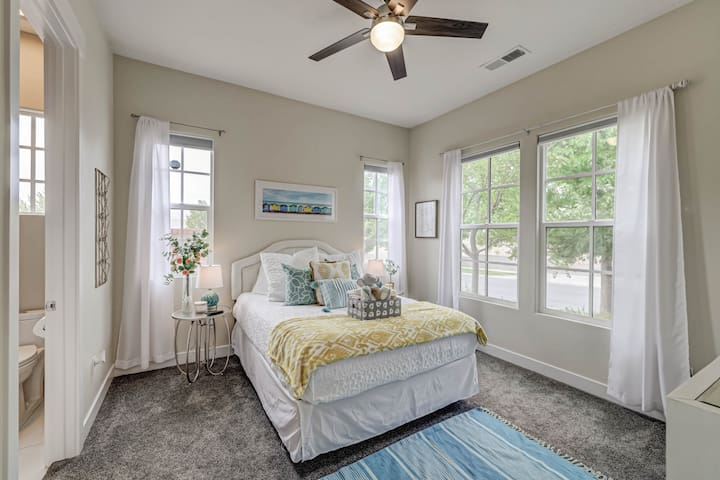 Guest bedroom with ensuite, queen size bed, Smart TV, and large windows!