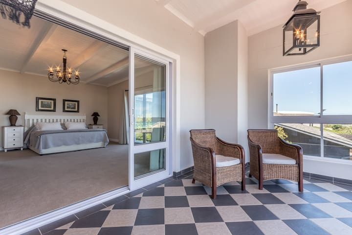 Indulge in breathtaking ocean scenery from the comfort of your king bed, and on warm days, your morning coffee can easily flow out to the balcony.