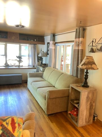 Hardwood floors and bright comfortable rooms make this the perfect place to stay. The view of the lake from the couch through the sliding glass door is enough to make indoor people happy!