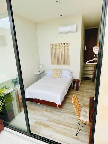 Tasteful bedroom with fridge and workstation, A/C & fan
