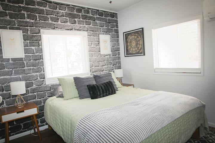 Bedroom 1 with queen size cozy bed.